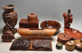 LARGE COLLECTION OF HAND CARVED BOXES, JARS, BOOKENDS