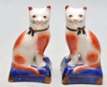 PAIR OF 19TH CENTURY CERAMIC STAFFORDSHIRE CATS