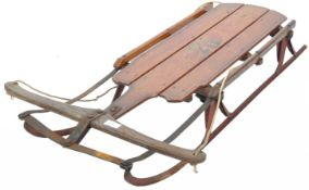 ANTIQUE AMERICAN THE FLYER WOODEN AND METAL SLEIGH