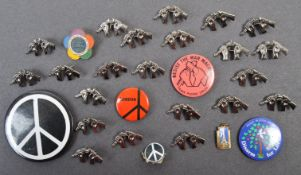 COLLECTION OF VINTAGE 190S ANTI-VIETNAM WAR BADGES