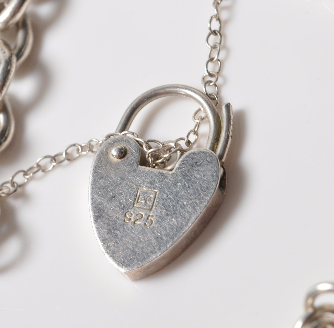 SILVER STAMPED 925 CHARM BRACELET. TOTAL WEIGHT 64 GRAMS. - Image 7 of 8