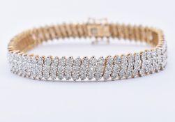 9CT GOLD AND DIAMOND TENNIS BRACELET
