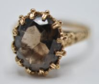 1970'S 9CT GOLD AND BROWN STONE RING