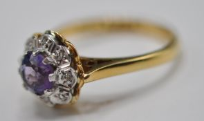 HALLMARKED 18CT GOLD LADIES RING WITH CENTRAL PURPLE STONE
