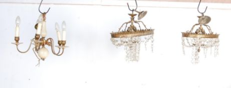 TWO EARLY 20TH CENTURY CAST METAL CHANDELIER AND A BRASS CHANDELIER