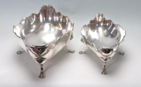 TWO ANTIQUE SILVER MATCHING FOOTED DISHES