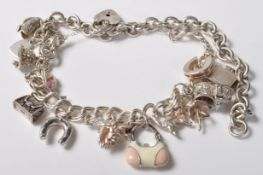 SILVER STAMPED 925 CHARM BRACELET. TOTAL WEIGHT 64 GRAMS.