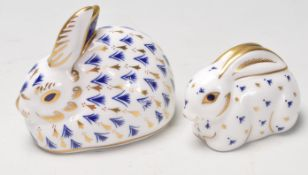TWO ROYAL CROWN DERBY RABBIT PAPERWEIGHTS WITH GOLD STOPPERS