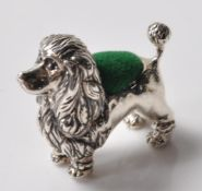 STAMPED 925 SILVER PIN CUSHION IN THE FORM OF A POODLE.