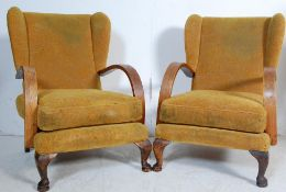 TWO ART DECO YELLOW FABRIC WINGBACK ARMCHAIRS
