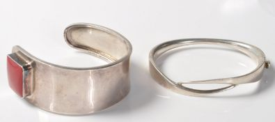 TWO SILVER STAMPED 925 BANGLE BRACELETS.