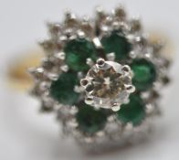 STAMPED 18CT GOLD RING WITH DIAMOND AND EMERALDS
