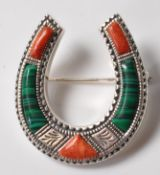 STERLING SILVER BROOCH IN THE FORM OF A HORSESHOE.