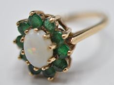 9CT GOLD OPAL AND GREEN STONE RING