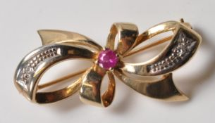 9CT GOLD PINK STONE AND DIAMOND BROOCH