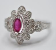 9CT WHITE GOLD PINK STONE AND DIAMOND RING