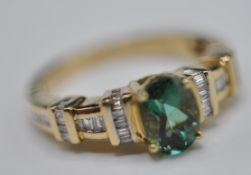 9CT GOLD LADIES DRESS RING WITH LARGE FACETED TOURMALINE STONE
