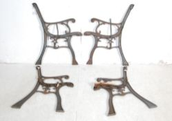 TWO PAIRS OF VICTORIAN INFLUNCE CAST IRON BENCH ENDS