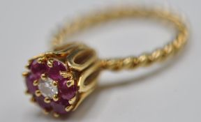 STAMPED 14CT GOLD RING WITH DIAMONDS AND RUBIES