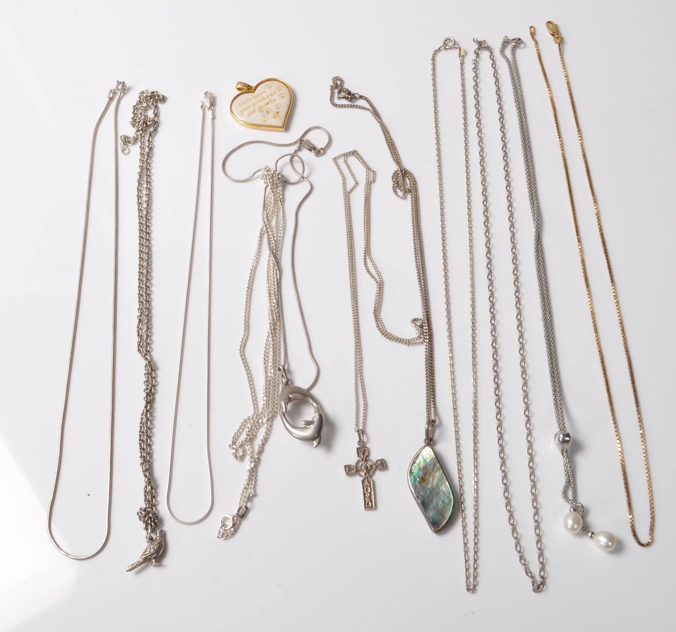 COLLECTION OF STAMPED 925 SILVER NECKLACES AND PENDANTS.
