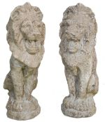 PAIR OF 20TH CENTURY RECONSTITUTED STONE LION STATUES