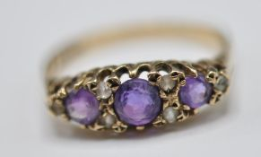 1920'S 9CT GOLD PURPLE AND WHITE STONE RING