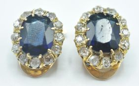 A pair of 14ct gold clip on, blue stone and diamon