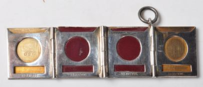 GRIFFITH & SONS SILVER STAMP CASE PENDANT