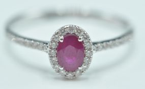 18CT WHITE GOLD LADIES DRESS RING WITH RUBY AND DI