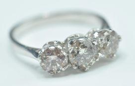18 CT GOLD AND THREE STONE DIAMOND RING