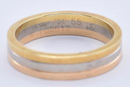 AN 18CT GOLD TRI COLOUR CARTIER BAND RING