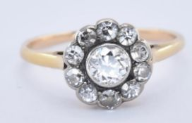 AN 18CT GOLD AND DIAMOND CLUSTER RING
