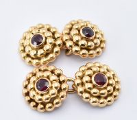 PAIR OF 18CT GOLD AND RUBY MELLERIO CUFFLINKS