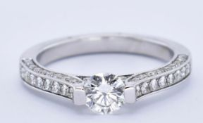 18CT GOLD AND DIAMOND TENSION SET SOLITAIRE RING