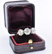 18CT WHITE GOLD AND DIAMOND THREE STONE RING