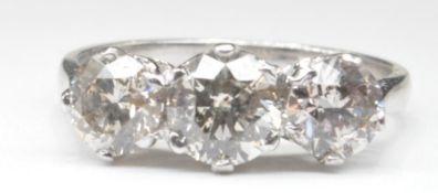 THREE STONE DIAMOND AND WHITE GOLD RING