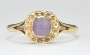 STAMPED 18K GOLD RING WITH PURPLE STONE