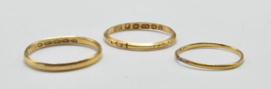 THREE ANTIQUE AND LATER GOLD BAND RINGS