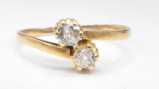 GOLD AND DIAMOND TWO STONE CORSSOVER RING