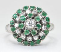 WHITE GOLD DIAMOND AND EMERALD CLUSTER RING