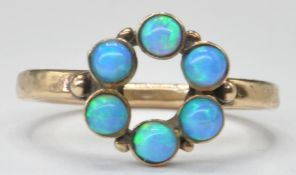 20TH CENTURY GOLD AND OPAL SET RING