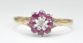 9CT GOLD DIAMOND AND PINK STONE CLUSTER RING