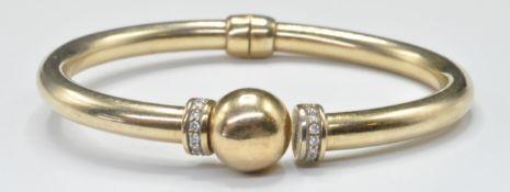 YELLOW METAL AND DIAMOND HINGED BANGLE BRACELET