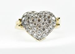 A 14CT GOLD AND DIAMOND METAMORPHIC HEART SWIVEL RING