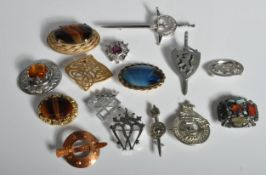 FIFTEEN VINTAGE SCOTTISH STYLE BROOCHES