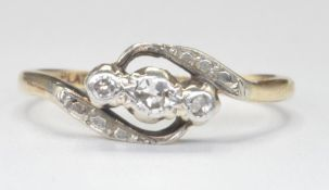 9CT GOLD AND DIAMOND CROSSOVER RING