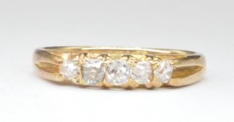 18CT GOLD AND DIAMOND FIVE STONE RING