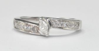 WHITE GOLD AND DIAMOND CROSSOVER RING