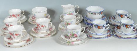 A COLLECTION OF THREE PART TEA SETS