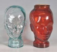 TWO VINTAGE RETRO 20TH CENTURY PRESSED GLASS HABERDASHERY HEADS